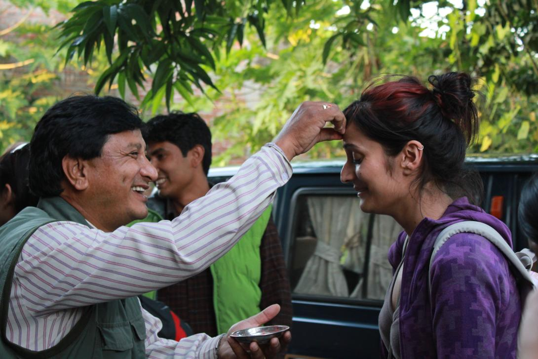 On a student placement abroad, a volunteer is welcomed to Nepal by her host family.